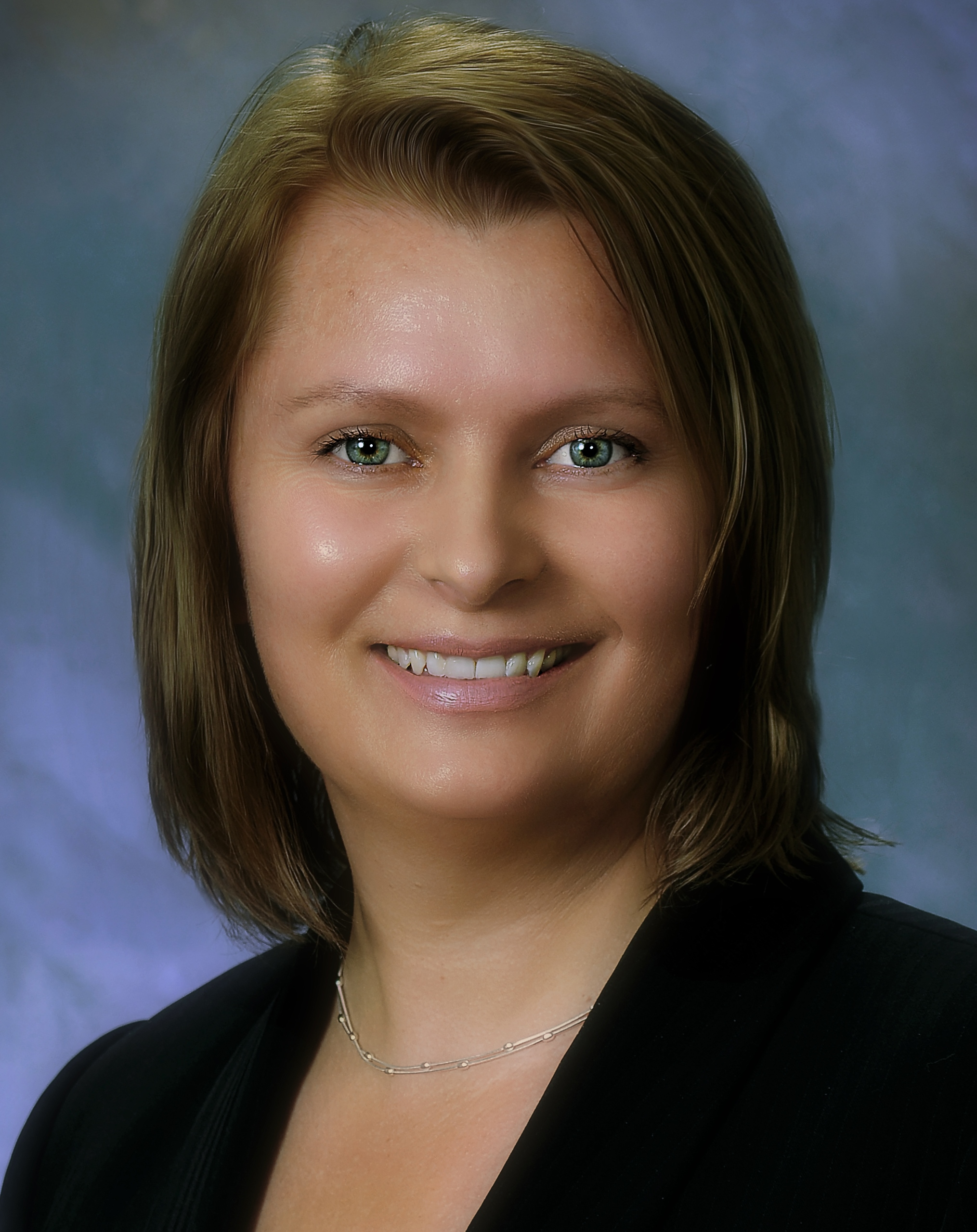Professional headshot of Dr. Angela Dolganiuc MD, PhD of Raleigh General Medical Group